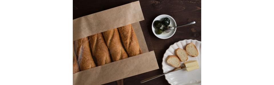 Confezionare il pane per il servizio a domicilio. Emergenza Coronavirus